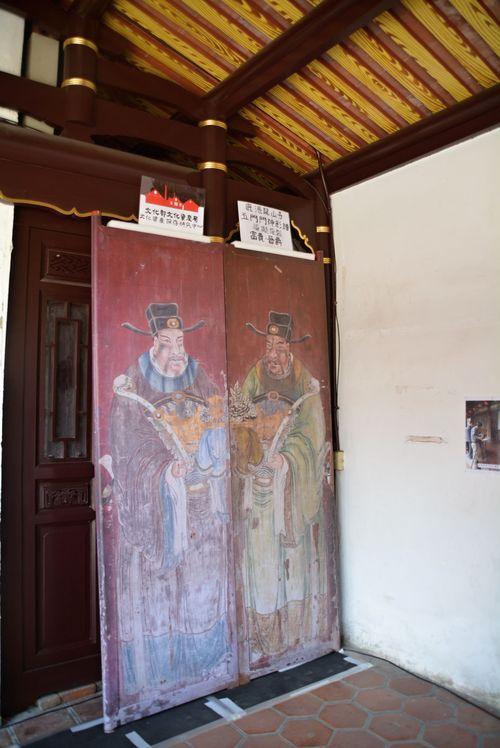 Replica of one of the five paris of door gods.