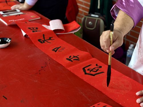 Traditional Chinese calligraphy couplet to welcome new year