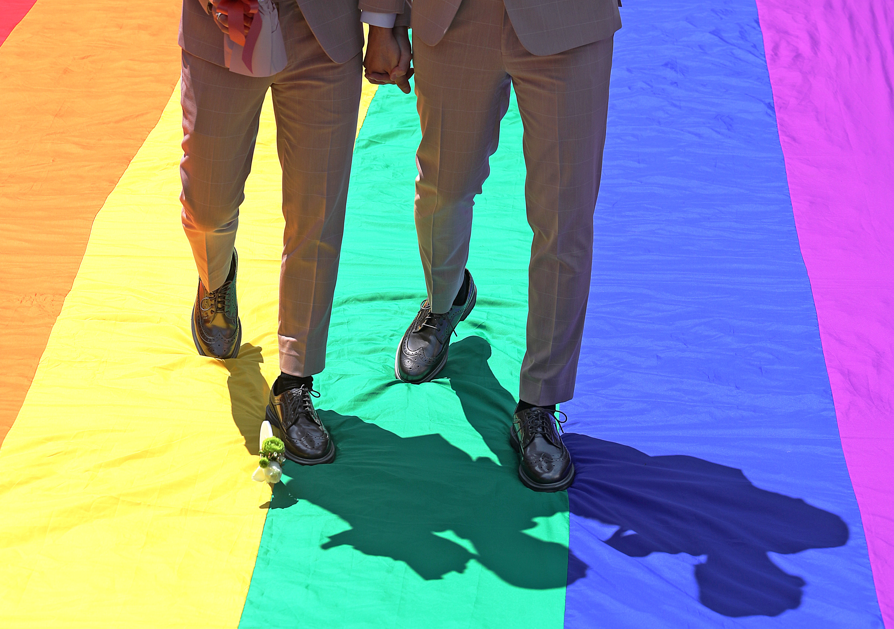 Gay couples celebrate first same-sex marriage registration day