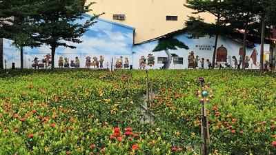 台中迎花博美化社區 磁磚拼40公尺故事牆