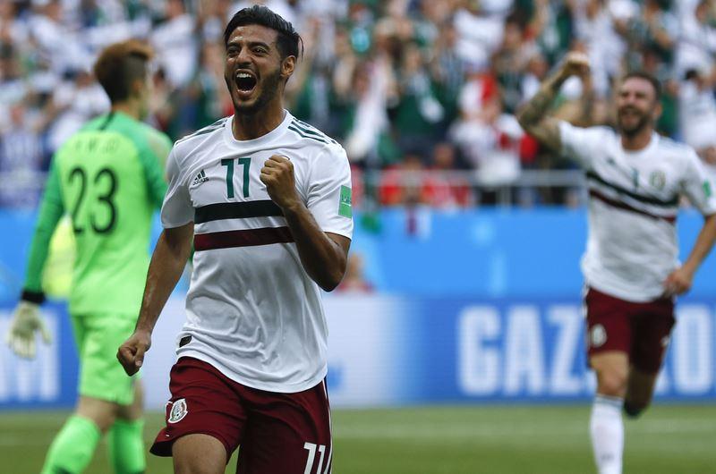 世界盃足球賽小組賽,墨西哥繼首戰1比0擊敗德國之後,23日再以2比1擊敗南韓。(達志提供)
