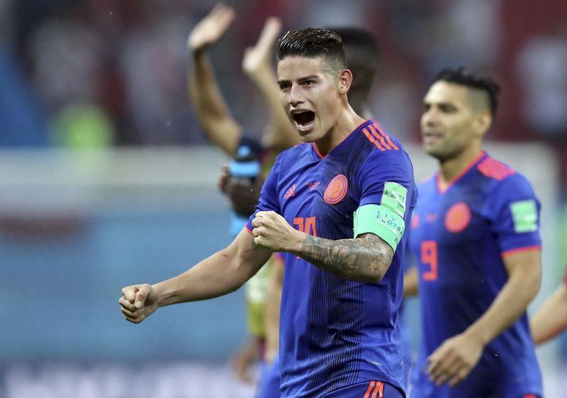 哥倫比亞24日在世界盃足球賽H組小組賽展現火力,當家球星「J羅」羅德里格斯(前)領軍,以3比0大勝歐洲強權波蘭。(達志提供)