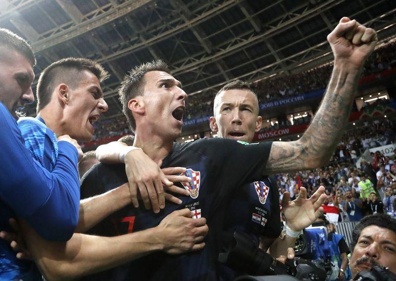 來自巴爾幹半島的克羅埃西亞「格子軍團」12日在世界盃足球4強賽拿下隊史首張冠軍賽門票。(達志提供)