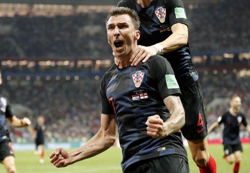 「格子軍團」克羅埃西亞12日在世足4強賽,與「三獅軍團」英格蘭鏖戰120分鐘,延長賽2比1勝出,拿下隊史首張冠軍賽門票。(達志提供)